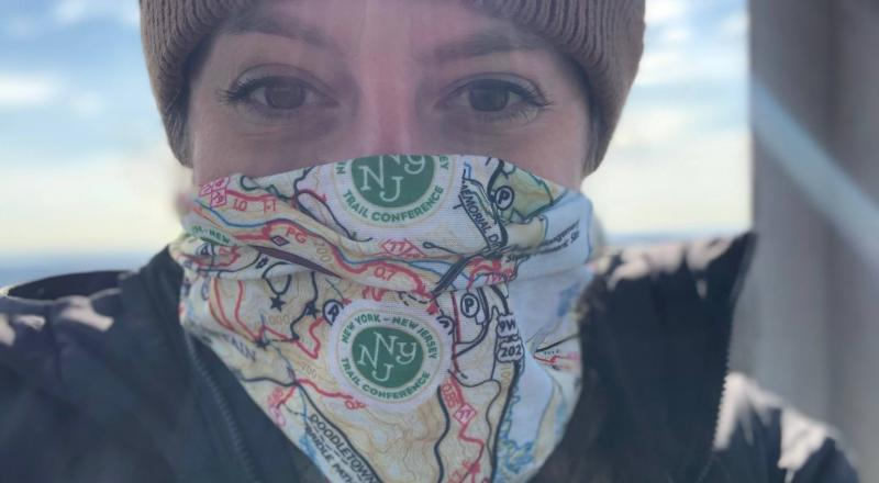Hiker with a Harriman-Bear Mountain Trails Map Neck Gaiter. Photo by Diana Richards.