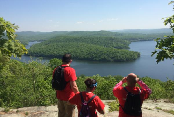 Hikers enjoy a scenic overlook of a lake in Norvin Green State Forest. Photo by Peter Dolan.