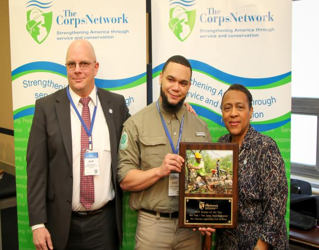 2019 Corps Network Project of the Year. Geoff Hamilton, Eduardo Gil, and Marie Walker, Chief Operating Officer of The Corps Network.