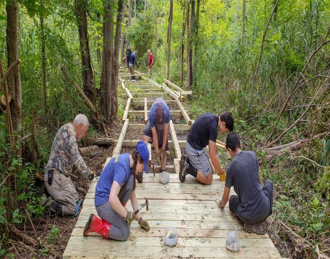 Westchester Trail Crew works on the Mohansic Trailway boardwalk. Photo by Jane Daniels.