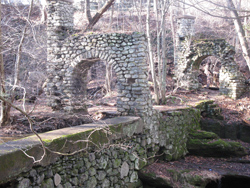 Stone arches that formerly supported bridge over creek. Photo by Daniel Chazin.